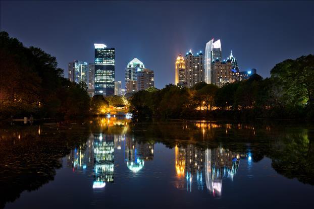 Midtown Atlanta skyline at dusk rising over Lake Clara Meer at the 2014 Dogwood Festival at Piedmont Park.