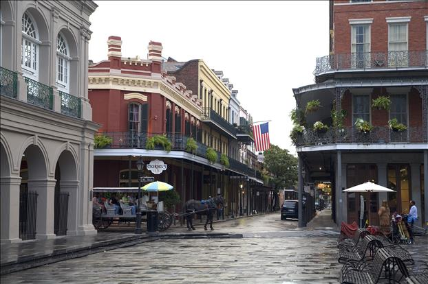 Street Scene in the French Quarter in Front of Saint Louis Cathedral.