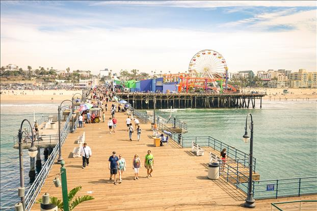 High angle view of Santa Monica Pier with ferris wheel of Pacific Amusement Park.