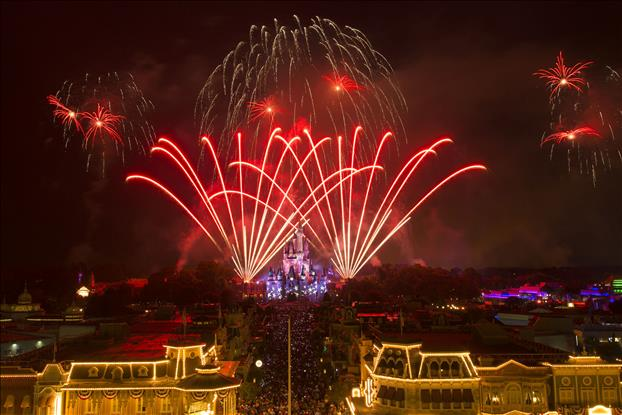 A red, white and blue fireworks spectacular illuminates the sky over Cinderella Castle at Magic Kingdom in Lake Buena Vista, Fla